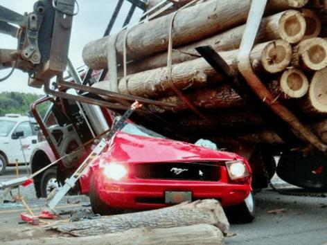 Rutledge Woman Survives 18-Wheeler Log Spill That Crushed Her Car